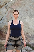 Smiling woman in rock climbing gear