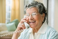 Senior Hispanic woman talking on cell phone