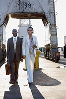 African American businesspeople walking on commercial pier