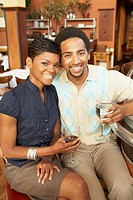 African American couple drinking wine