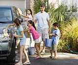 Hispanic family washing car