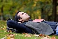 Hispanic man laying in grass
