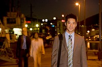Asian businessman outdoors at night
