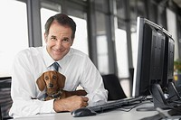 Businessman with dachshund