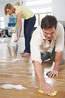 Couple scrubbing floor