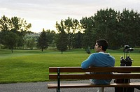 Golfer on a bench