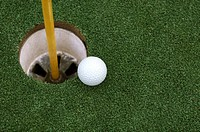 Golf ball and golf cup
