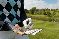 Golfer with a score card
