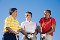 Multi-ethnic men holding golf clubs