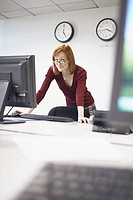 Woman leaning on desk (thumbnail)