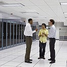 Co-workers talking in server room