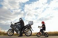 Young boy following biker
