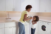 Mother and daughter in the laundry room