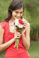 Woman holding a flower bouquet