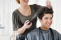 Hairstylist using hairspray