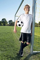 Soccer player leaning against goal post