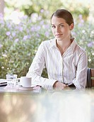 Businesswoman on outdoor patio