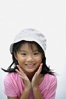 Young girl indoors smiling (thumbnail)