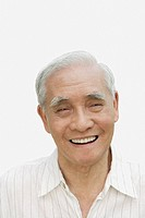 Man indoors smiling