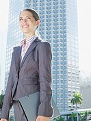Businesswoman outdoors holding folder