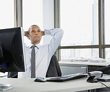 Businessman in office daydreaming