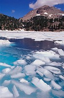 Lake Helen thawing in summer below Lassen Peak, Lassen Volcanic National Park. California, USA