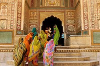 Tradtional Indian women entering the a building at amber fort, Jaipur. Rajasthan, India