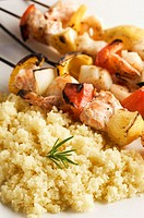 Grilled seafood kebabs with couscous