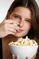 Young woman with a bowl of popcorn