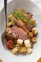 Duck breast with vegetables overhead view