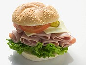 Sesame roll filled with ham, cheese, lettuce and tomato
