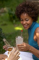 Woman with a glass of lemonade at a garden party
