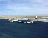 This photo shows NASA's PIK_20 motor_glider sailplane on the ramp at the Dryden Flight Research Center, Edwards, California. Next to the PIK_20 is the...