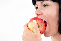 woman eats apple