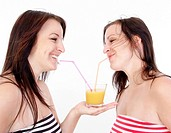 twins drinking orange juice