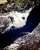 The ice_ and snow_covered Selenga River delta can be seen in the center of the scene as it extends outward into Lake Baikal Baykal in this south_looki...