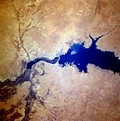 Completed in 1973, the Tabaqah Dam center of image on the Euphrates River can be seen in this near_nadir view. The Tabaqah Dam is an earth filled dam ...