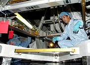 07/22/2002 __ STS_113 Mission Specialist John Herrington looks over part of the payload for the mission during Crew Equipment Interface Test activitie...
