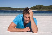 Man lying on a beautiful beach. Fraser Island, Australia