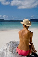 Back of a topless woman in a cowboy hat, Witehaven Beach, Australia