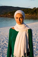 Portrait of woman wearing a headscarf.  Whitehaven Beach, Australia