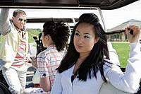 Portrait of a woman sitting inside a golf cart