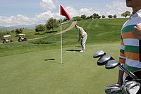 View of a man playing golf game