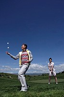 View of a couple in a golf course