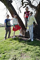 View of four people at a large tree