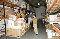 View of two men working inside a warehouse