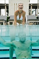 View of a couple underwater in a swimming pool (thumbnail)