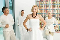 Group of four mature adults all dressed in white (thumbnail)