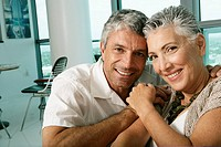 Mature couple looking at camera smiling (thumbnail)