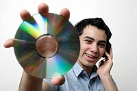 View of a teenage boy holding a CD